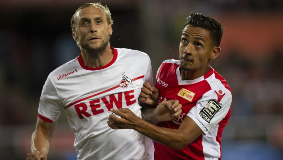 COLOGNE, GERMANY - AUGUST 13: Marcel Risse of Cologne (L) and Kenny Prince Redondo of Union Berlin compete during the Second Bundesliga match between 1. FC Koeln and 1. FC Union Berlin at RheinEnergieStadion on August 13, 2018 in Cologne, Germany. (Photo by Juergen Schwarz/Bongarts/Getty Images)