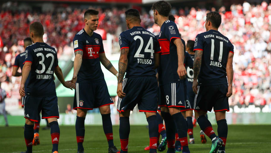COLOGNE, GERMANY - MAY 05: Corentin Tolisso #24 of Bayern Munich celebrates with his team-mates after scoring his teams goal to make it 1-3 during the Bundesliga match between 1. FC Koeln and FC Bayern Muenchen at RheinEnergieStadion on May 5, 2018 in Cologne, Germany. (Photo by Maja Hitij/Bongarts/Getty Images)