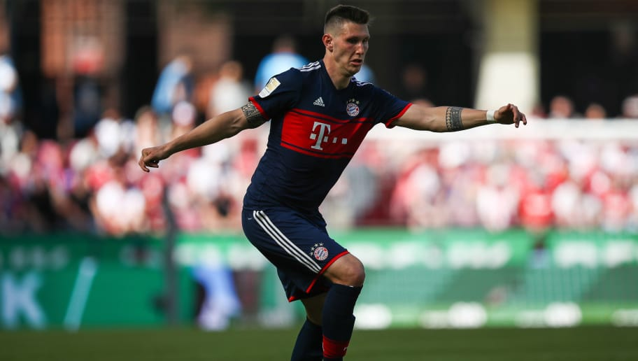 COLOGNE, GERMANY - MAY 05: Niklas Sule #4 of Bayern Munich controls the ball during the Bundesliga match between 1. FC Koeln and FC Bayern Muenchen at RheinEnergieStadion on May 5, 2018 in Cologne, Germany. (Photo by Maja Hitij/Bongarts/Getty Images)