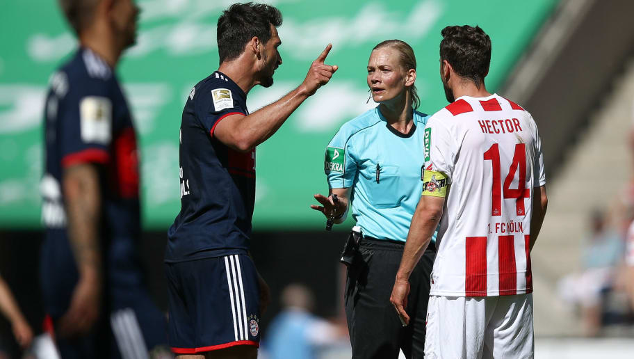 COLOGNE, GERMANY - MAY 05: Mats Hummels #5 of Bayern Munich and Jonas Hector #14 of 1.FC Koeln argue with referee Bibiana Steinhaus during the Bundesliga match between 1. FC Koeln and FC Bayern Muenchen at RheinEnergieStadion on May 5, 2018 in Cologne, Germany. (Photo by Maja Hitij/Bongarts/Getty Images)