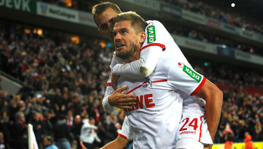 COLOGNE, GERMANY - SEPTEMBER 25: Simon Terodde of FC Koeln celebrates after scoring his team`s second goal with team mates during the Second Bundesliga match between 1. FC Koeln and FC Ingolstadt 04 at RheinEnergieStadion on September 25, 2018 in Cologne, Germany. (Photo by TF-Images/Getty Images)