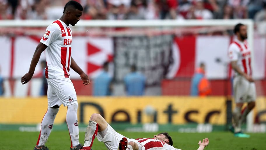 COLOGNE, GERMANY - APRIL 22: Jhon Cordoba (L) and Jonas Hector of Koeln look dejected after the Bundesliga match between 1. FC Koeln and FC Schalke 04 at RheinEnergieStadion on April 22, 2018 in Cologne, Germany.  (Photo by Lars Baron/Bongarts/Getty Images)