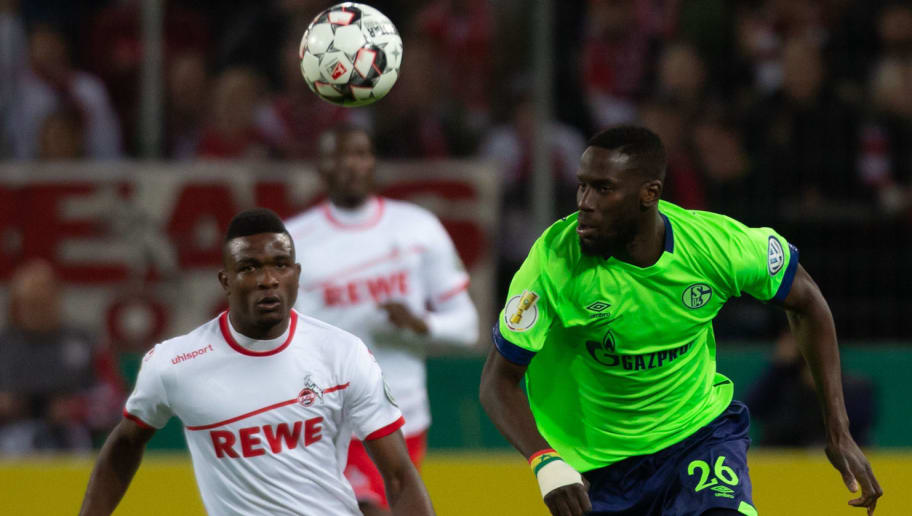 COLOGNE, GERMANY - OCTOBER 31: Jhon Cordoba of FC Koeln and Salif Sane of FC Schalke battle for the ball during the DFB Cup match between 1. FC Koeln and FC Schalke 04 at RheinEnergieStadion on October 31, 2018 in Cologne, Germany. (Photo by TF-Images/Getty Images)