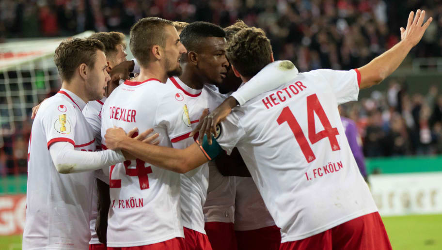COLOGNE, GERMANY - OCTOBER 31: Jhon Cordoba of FC Koeln celebrates after scoring his team`s first goal with team mates during the DFB Cup match between 1. FC Koeln and FC Schalke 04 at RheinEnergieStadion on October 31, 2018 in Cologne, Germany. (Photo by TF-Images/Getty Images)