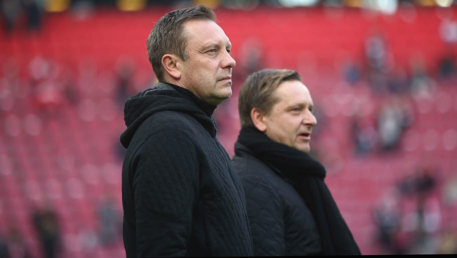 COLOGNE, GERMANY - FEBRUARY 17: Head coach Andre Breitenreiter and sport director Horst Heldt of Hannover look on prior to the Bundesliga match between 1. FC Koeln and Hannover 96 at RheinEnergieStadion on February 17, 2018 in Cologne, Germany.  (Photo by Alex Grimm/Bongarts/Getty Images)