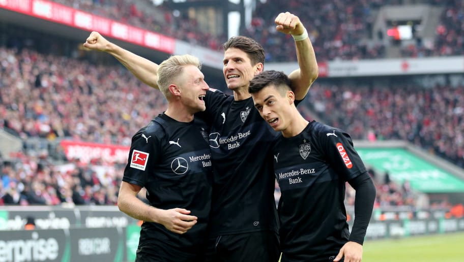 COLOGNE, GERMANY - MARCH 04: Andreas Beck of Stuttgart celebrates the third goal with Mario Gomez of Stuttgart (C) and Erik Thommy of Stuttgart (R) during the Bundesliga match between 1. FC Koeln and VfB Stuttgart at RheinEnergieStadion on March 4, 2018 in Cologne, Germany. (Photo by Christof Koepsel/Bongarts/Getty Images)