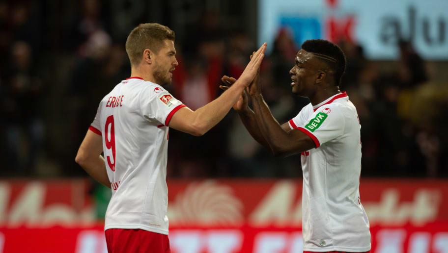 COLOGNE, GERMANY - DECEMBER 21: Simon Terodde of Cologne (L) and Jhon Cordoba celebrate after scoring during the Second Bundesliga match between 1. FC Koeln and VfL Bochum 1848 at RheinEnergieStadion on December 21, 2018 in Cologne, Germany. (Photo by Juergen Schwarz/Bongarts/Getty Images)