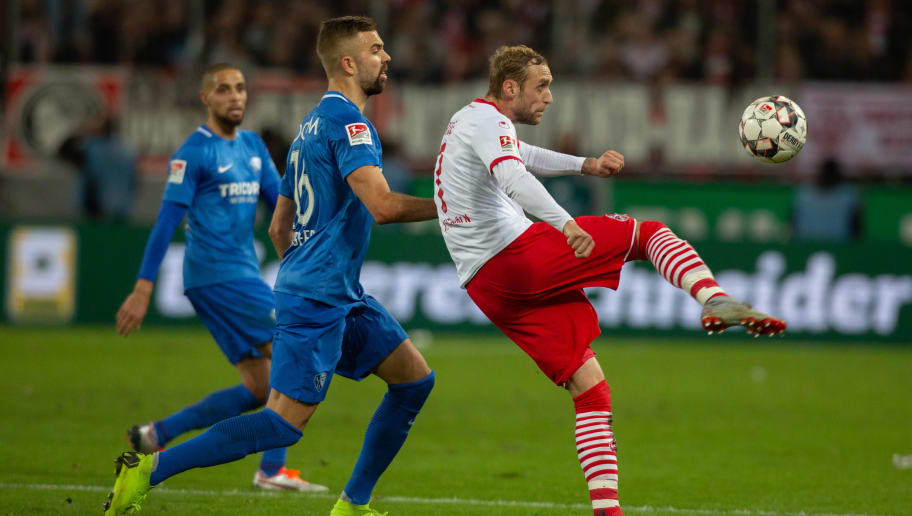COLOGNE, GERMANY - DECEMBER 21: Lukas Hinterseer of Bochum (C) and Marcel Risse of Cologne (L) compete during the Second Bundesliga match between 1. FC Koeln and VfL Bochum 1848 at RheinEnergieStadion on December 21, 2018 in Cologne, Germany. (Photo by Juergen Schwarz/Bongarts/Getty Images)