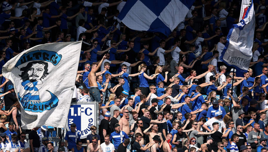 MAGDEBURG, GERMANY - MAY 05:  Supporters of 1. FC Magdeburg cheer during the 3. Liga match between 1. FC Magdeburg and Chemnitzer FC at MDCC-Arena on May 5, 2018 in Magdeburg, Germany. (Photo by Ronny Hartmann/Bongarts/Getty Images)