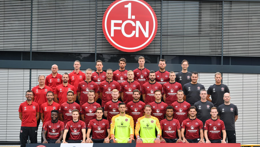 NUREMBERG, GERMANY - JULY 16: Back row, (L-R) Nate Weiss, Martin Scharrer, Georg Margreitter, Lukas Muehl, Patrick Erras, Eduard Loewen, Sascha Rurainski. Second row from top (L-R) Florian Klausner, Fabian Adelmann, Ondrej Petrak, Ewerton, Hanno Behrens, Mikael Ishak, Lukas Jaeger, Milan Gubov, James Morgan. Second row from bottom (L-R), head coach Michael Koellner, Boris Schommers, Kevin Goden, Toerles Knoell, Sebastian Kerk, Enrico Valentini, Robert Bauer, Adam Zrelak, Marko Riegel Matthias Brem. Front row (L-R),  Edgar Salli, Dennis Lippert, Alexander Fuchs, Fabian Bredlow, Christian Mathenia, Timothy Tillman, Tim Leibold, Federico Palacios of 1. FC Nuernberg pose during the team presentation at Sportpark Valznerweiher on July 16, 2018 in Nuremberg, Germany. (Photo by Sebastian Widmann/Bongarts/Getty Images)