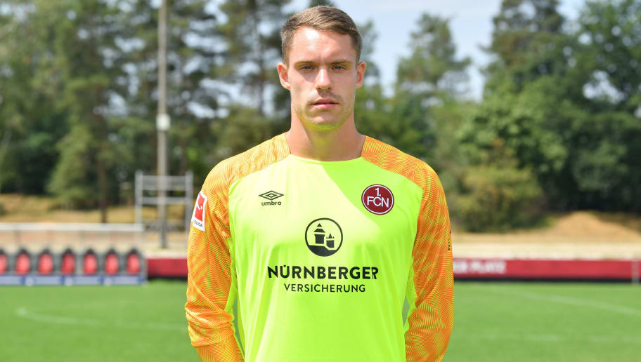 NUREMBERG, GERMANY - JULY 16: Christian Mathenia of 1. FC Nuernberg poses during the team presentation at Sportpark Valznerweiher on July 16, 2018 in Nuremberg, Germany. (Photo by Sebastian Widmann/Bongarts/Getty Images)