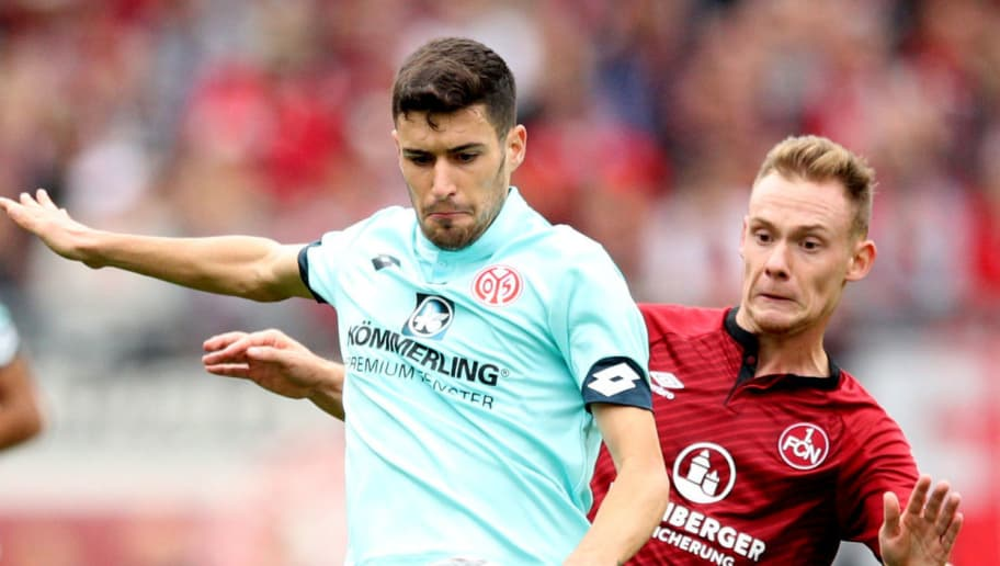 NUREMBERG, GERMANY - SEPTEMBER 01:  Aaron Martin Caricol of FSV Mainz 05 is challenged by Federico Palacios Martinez of Nuernberg during the Bundesliga match between 1. FC Nuernberg and 1. FSV Mainz 05 at Max-Morlock-Stadion on September 1, 2018 in Nuremberg, Germany.  (Photo by Adam Pretty/Bongarts/Getty Images)