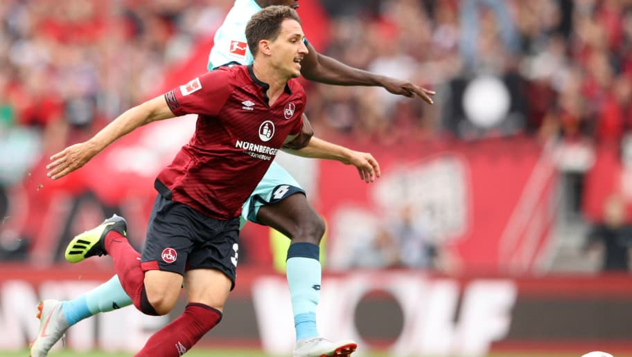 NUREMBERG, GERMANY - SEPTEMBER 01: Georg Margreitter of Nuernburg and Jean-Philippe Mateta of FSV Mainz battle for the ball during the Bundesliga match between 1. FC Nuernberg and 1. FSV Mainz 05 at Max-Morlock-Stadion on September 1, 2018 in Nuremberg, Germany.  (Photo by Adam Pretty/Bongarts/Getty Images)