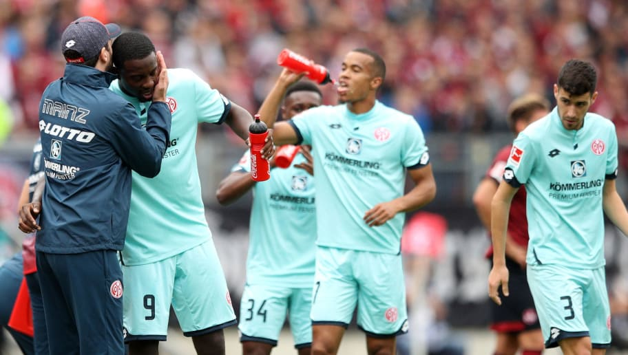 NUREMBERG, GERMANY - SEPTEMBER 01:  Jean-Philippe Mateta of FSV Mainz celebrates after scoring his team's first goal with Sandro Schwarz manager of FSV Mainz during the Bundesliga match between 1. FC Nuernberg and 1. FSV Mainz 05 at Max-Morlock-Stadion on September 1, 2018 in Nuremberg, Germany.  (Photo by Adam Pretty/Bongarts/Getty Images)
