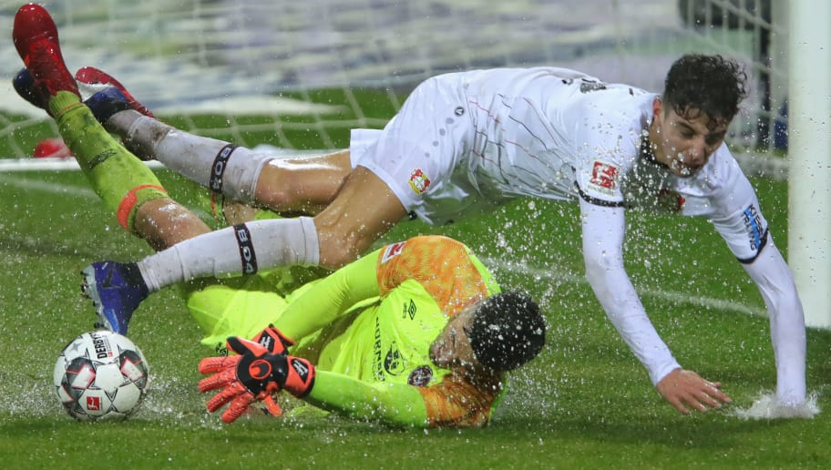 NUREMBERG, GERMANY - DECEMBER 03:  Kai Havertz of Leverkusen battels for the ball with keeper Fabian Bredlow of Nuernberg  during the Bundesliga match between 1. FC Nuernberg and Bayer 04 Leverkusen at Max-Morlock-Stadion on December 1, 2018 in Nuremberg, Germany.  (Photo by Alexander Hassenstein/Bongarts/Getty Images)
