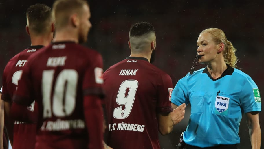 NUREMBERG, GERMANY - DECEMBER 03:  Referee Bibiana Steinhaus reacts to the players during the Bundesliga match between 1. FC Nuernberg and Bayer 04 Leverkusen at Max-Morlock-Stadion on December 1, 2018 in Nuremberg, Germany.  (Photo by Alexander Hassenstein/Bongarts/Getty Images)
