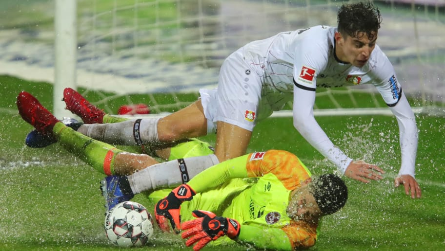 NUREMBERG, GERMANY - DECEMBER 03:  Fabian Bredlow of Nuernberg makes a save from Kai Havertz of Bayer 04 Leverkusen during the Bundesliga match between 1. FC Nuernberg and Bayer 04 Leverkusen at Max-Morlock-Stadion on December 3, 2018 in Nuremberg, Germany.  (Photo by Alexander Hassenstein/Bongarts/Getty Images)