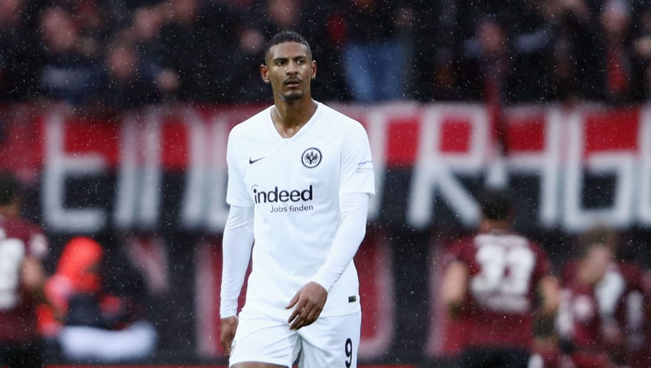 NUREMBERG, GERMANY - OCTOBER 28: Sebastian Haller of Frankfurt reacts as Adam Zrelak of Nuernberg celebrates his team's first goal with team mates during the Bundesliga match between 1. FC Nuernberg and Eintracht Frankfurt at Max-Morlock-Stadion on October 28, 2018 in Nuremberg, Germany.  (Photo by Alex Grimm/Bongarts/Getty Images)
