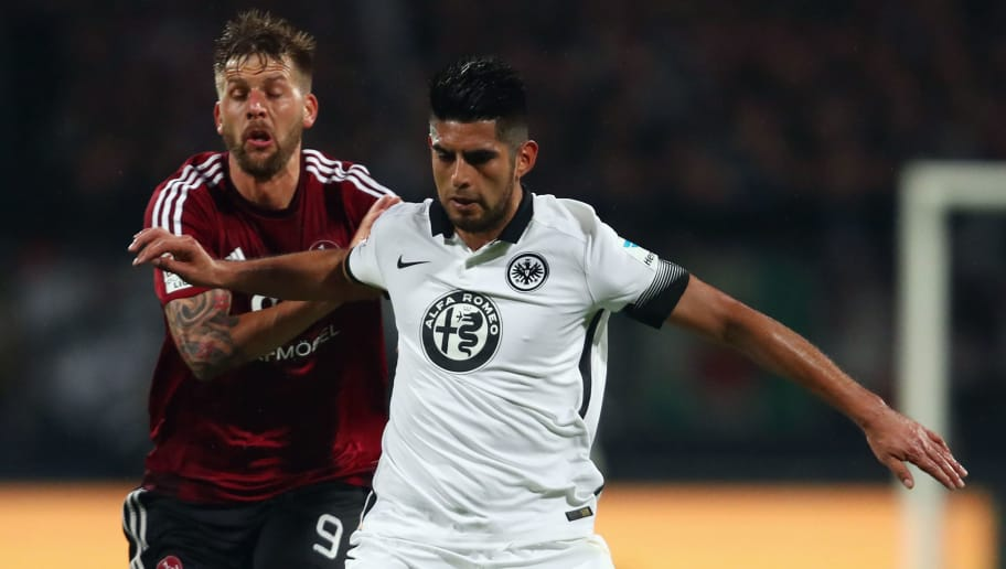 NUREMBERG, GERMANY - MAY 23: Carlos Zambrano (R) of Frankfurt is challenged by Guido Burgstaller of Nuernberg during the Bundesliga Playoff Leg 2 between 1. FC Nuernberg and Eintracht Frankfurt at Grundig-Stadion on May 23, 2016 in Nuremberg, Germany.  (Photo by Alex Grimm/Bongarts/Getty Images)