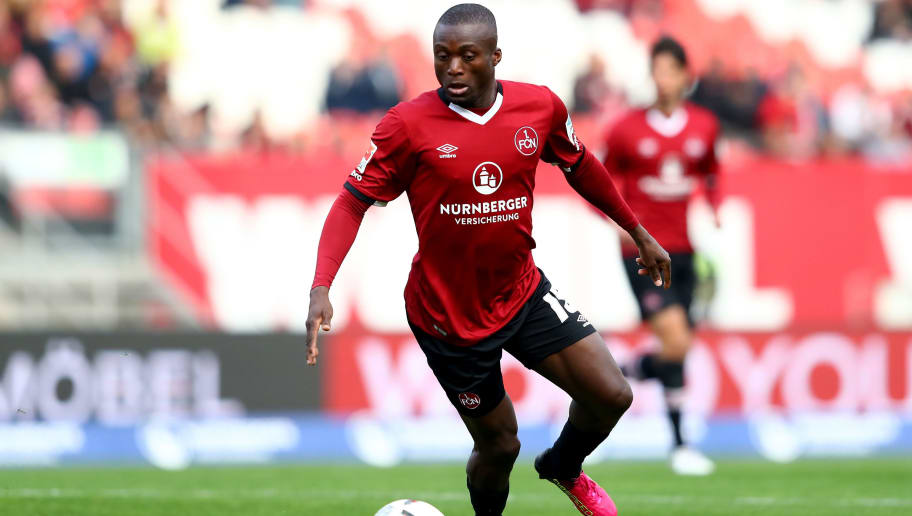 NUREMBERG, GERMANY - APRIL 07:  Constant Djakpa of Nuernberg runs with the ball during the Second Bundesliga match between 1. FC Nuernberg and FC St. Pauli at Arena Nuernberg on April 7, 2017 in Nuremberg, Germany.  (Photo by Alexander Hassenstein/Bongarts/Getty Images)