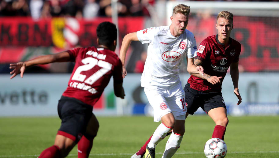 NUREMBERG, GERMANY - SEPTEMBER 29:  Marvin Ducksch of Fortuna Duesseldorf competes for the ball with Matheus Pereira (l) and Ondrej Petrak of Nuernberg during the Bundesliga match between 1. FC Nuernberg and Fortuna Duesseldorf at Max-Morlock-Stadion on September 29, 2018 in Nuremberg, Germany.  (Photo by Alexander Hassenstein/Bongarts/Getty Images)