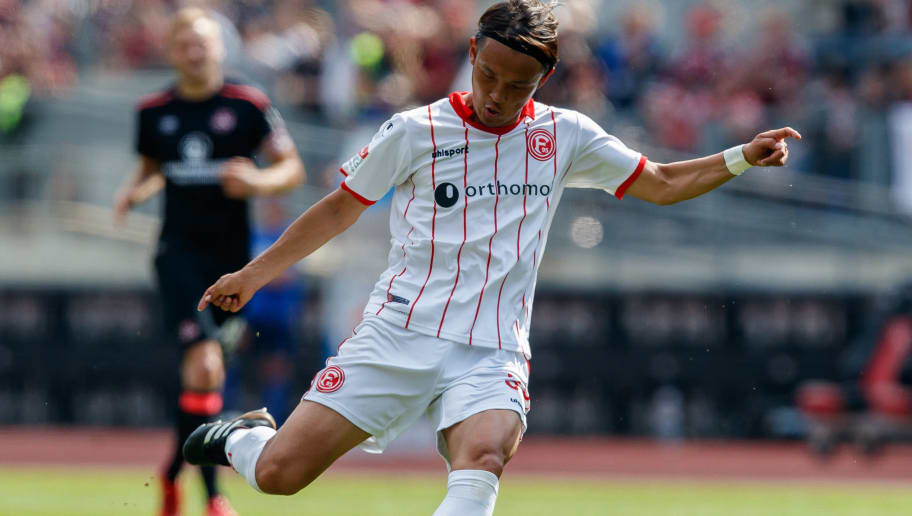 NUREMBERG, GERMANY - MAY 13: Takashi Usami of Duesseldorf controls the ball during the Second Bundesliga match between 1. FC Nuernberg and Fortuna Duesseldorf at Max-Morlock-Stadion on May 13, 2018 in Nuremberg, Germany. (Photo by TF-Images/Getty Images)