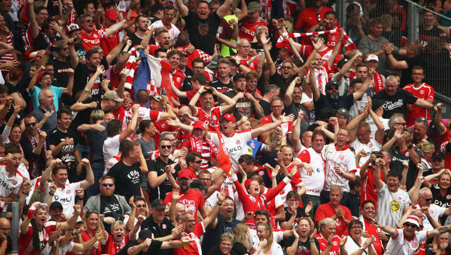 NUREMBERG, GERMANY - MAY 13:  Fans celebrate after Kaan Ayhan of Fortuna Duesseldorf scores the winning goal and securing victory in the match and winning the Bundesliga 2 championship during the Second Bundesliga match between 1. FC Nuernberg and Fortuna Duesseldorf at Max-Morlock-Stadion on May 13, 2018 in Nuremberg, Germany.  (Photo by Adam Pretty/Bongarts/Getty Images)
