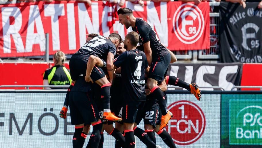NUREMBERG, GERMANY - MAY 13: Tim Leibold of Nuernberg celebrates after scoring his team`s second goal with team mates during the Second Bundesliga match between 1. FC Nuernberg and Fortuna Duesseldorf at Max-Morlock-Stadion on May 13, 2018 in Nuremberg, Germany. (Photo by TF-Images/Getty Images)