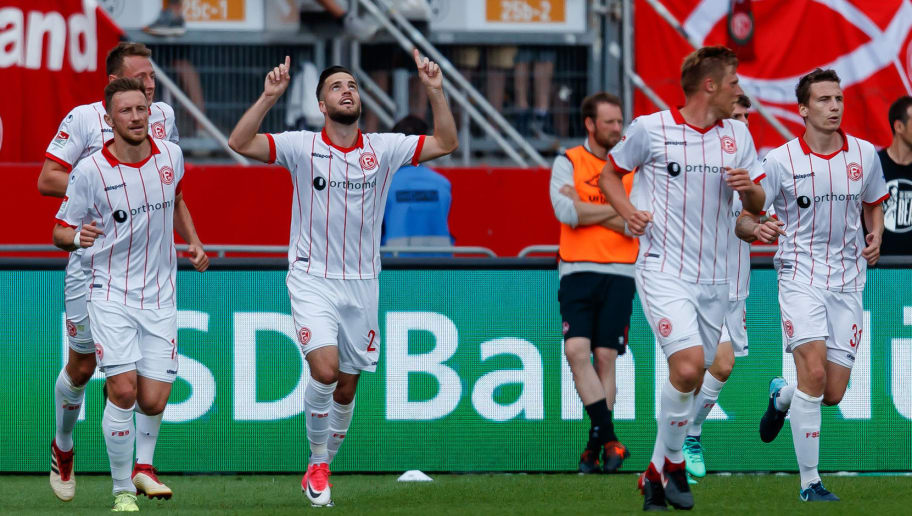 NUREMBERG, GERMANY - MAY 13: Niko Gießelmann of Duesseldorf celebrates after scoring his team`s second goal during the Second Bundesliga match between 1. FC Nuernberg and Fortuna Duesseldorf at Max-Morlock-Stadion on May 13, 2018 in Nuremberg, Germany. (Photo by TF-Images/Getty Images)