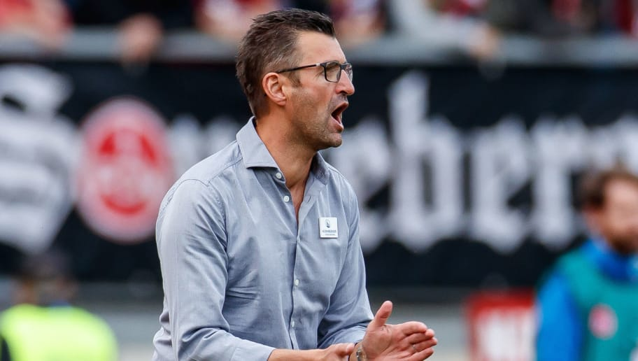 NUREMBERG, GERMANY - SEPTEMBER 22: Head coach Michael Koellner of FC Nuernberg gestures during the Bundesliga match between 1. FC Nuernberg and Hannover 96 at Max-Morlock-Stadion on September 22, 2018 in Nuremberg, Germany. (Photo by TF-Images/Getty Images)