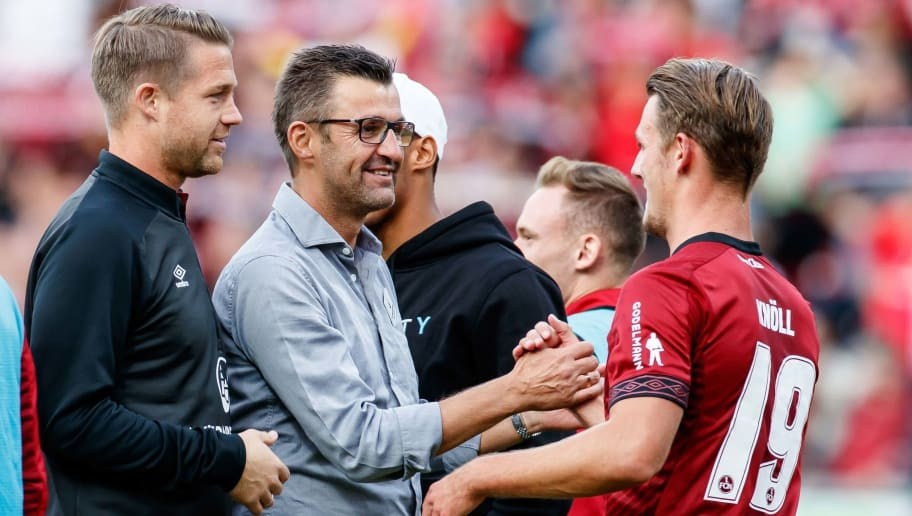 NUREMBERG, GERMANY - SEPTEMBER 22: Head coach Michael Koellner of FC Nuernberg and Toerles Knoell of FC Nuernberg celebrate after winning the Bundesliga match between 1. FC Nuernberg and Hannover 96 at Max-Morlock-Stadion on September 22, 2018 in Nuremberg, Germany. (Photo by TF-Images/Getty Images)