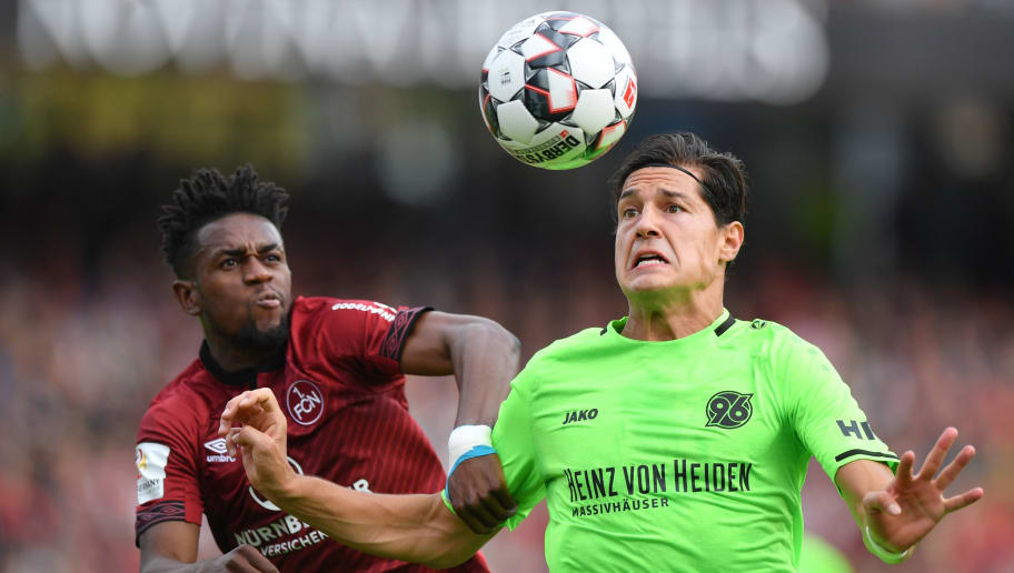 NUREMBERG, GERMANY - SEPTEMBER 22: Virgil Misidjan of Nuernberg and Miiko Albornoz of Hannover compete for the ball during the Bundesliga match between 1. FC Nuernberg and Hannover 96 at Max-Morlock-Stadion on September 22, 2018 in Nuremberg, Germany. (Photo by Sebastian Widmann/Bongarts/Getty Images)