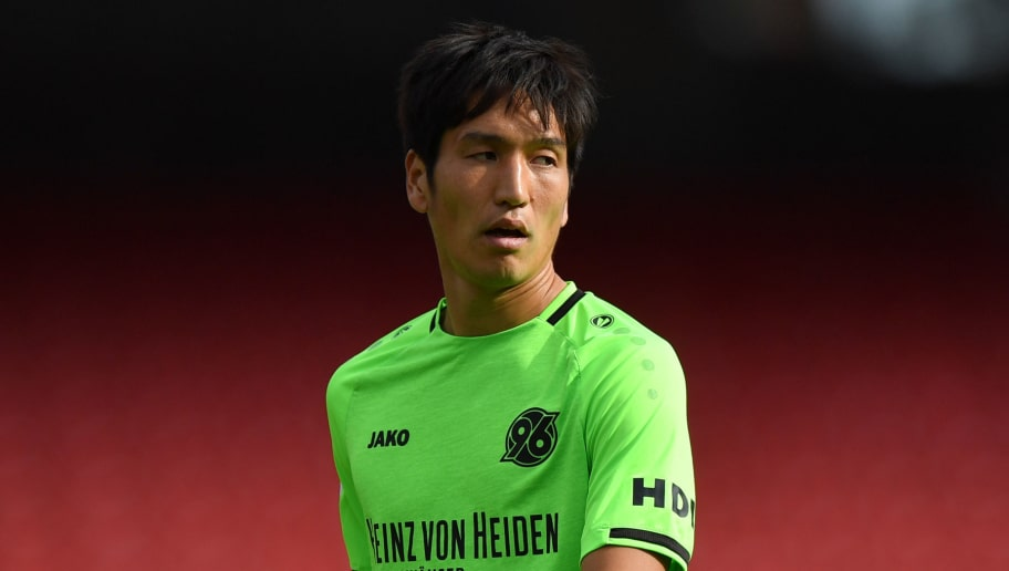 NUREMBERG, GERMANY - SEPTEMBER 22: Genki Haraguchi of Hannover looks on during the Bundesliga match between 1. FC Nuernberg and Hannover 96 at Max-Morlock-Stadion on September 22, 2018 in Nuremberg, Germany. (Photo by Sebastian Widmann/Bongarts/Getty Images)