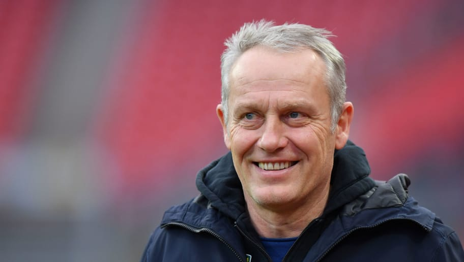 NUREMBERG, GERMANY - DECEMBER 22: Head coach Christian Streich of Freiburg looks on prior to the Bundesliga match between 1. FC Nuernberg and Sport-Club Freiburg at Max-Morlock-Stadion on December 22, 2018 in Nuremberg, Germany. (Photo by Sebastian Widmann/Bongarts/Getty Images)