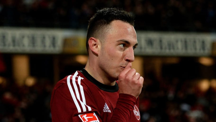 NUREMBERG, GERMANY - MARCH 26:  Josip Drmic of Nuernberg celebrates after scoring his team's second goal during the Bundesliga match between 1. FC Nuernberg and VfB Stuttgart at Grundig Stadium on March 26, 2014 in Nuremberg, Germany.  (Photo by Micha Will/Bongarts/Getty Images)