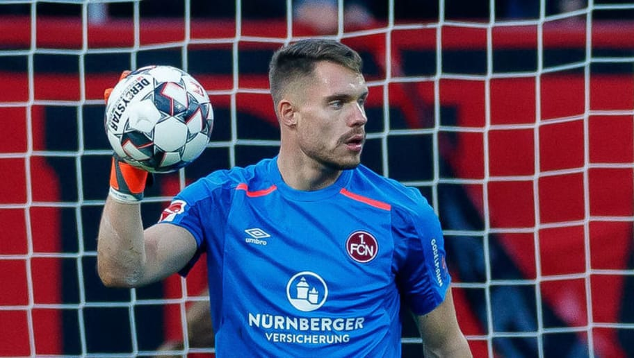 NUREMBERG, GERMANY - NOVEMBER 10: goalkeeper Christian Mathenia of 1. FC Nuernberg controls the ball during the Bundesliga match between 1. FC Nuernberg and VfB Stuttgart at Max-Morlock-Stadion on November 10, 2018 in Nuremberg, Germany. (Photo by TF-Images/Getty Images)