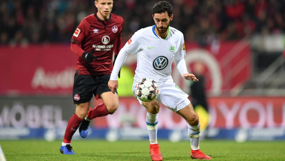 NUREMBERG, GERMANY - DECEMBER 14: Yunus Malli of Wolfsburg plays the ball during the Bundesliga match between 1. FC Nuernberg and VfL Wolfsburg at Max-Morlock-Stadion on December 14, 2018 in Nuremberg, Germany. (Photo by Sebastian Widmann/Bongarts/Getty Images)