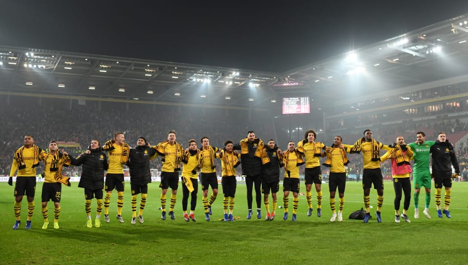 MAINZ, GERMANY - NOVEMBER 24:  Borussia Dortmund players celebrate with their fans after their victory in the Bundesliga match between 1. FSV Mainz 05 and Borussia Dortmund at Opel Arena on November 24, 2018 in Mainz, Germany.  (Photo by Matthias Hangst/Bongarts/Getty Images)