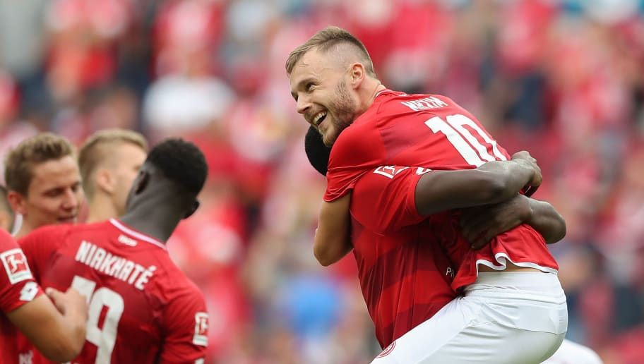 MAINZ, GERMANY - SEPTEMBER 15: Alexandru Maxim of Mainz celebrates with Anthony Ujah of Mainz after the Bundesliga match between 1. FSV Mainz 05 and FC Augsburg at Opel Arena on September 15, 2018 in Mainz, Germany. (Photo by Christian Kaspar-Bartke/Bongarts/Getty Images)