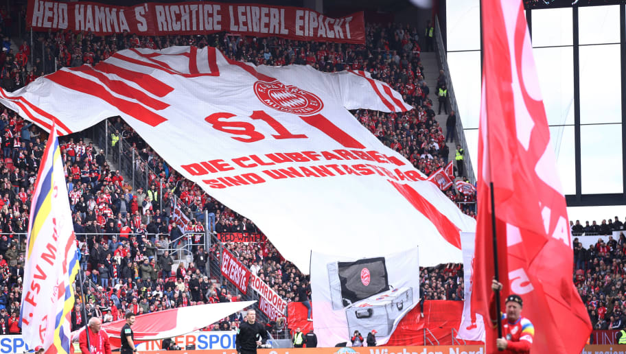 MAINZ, GERMANY - OCTOBER 27:  Fans display a flag in the shape of a shirt prior to the Bundesliga match between 1. FSV Mainz 05 and FC Bayern Muenchen at Opel Arena on October 27, 2018 in Mainz, Germany.  (Photo by Alex Grimm/Bongarts/Getty Images)