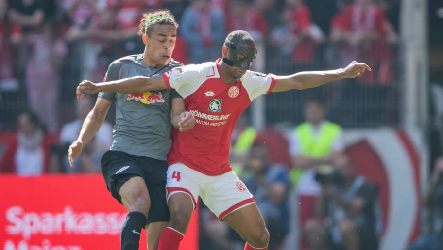 MAINZ, GERMANY - APRIL 29: Diallo Abdou of Mainz is challenged by Yussuf Poulsen of Leipzig during the Bundesliga match between 1. FSV Mainz 05 and RB Leipzig at Opel Arena on April 28, 2018 in Mainz, Germany. (Photo by Simon Hofmann/Bongarts/Getty Images)