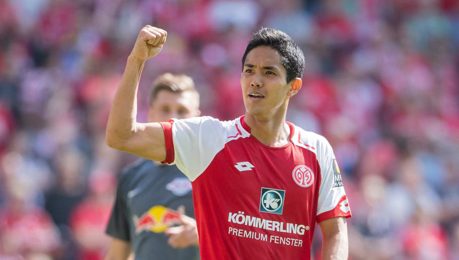 MAINZ, GERMANY - APRIL 29: Yoshinori Muto of Mainz celebrates after a penalty whistle during the Bundesliga match between 1. FSV Mainz 05 and RB Leipzig at Opel Arena on April 28, 2018 in Mainz, Germany. (Photo by Simon Hofmann/Bongarts/Getty Images)