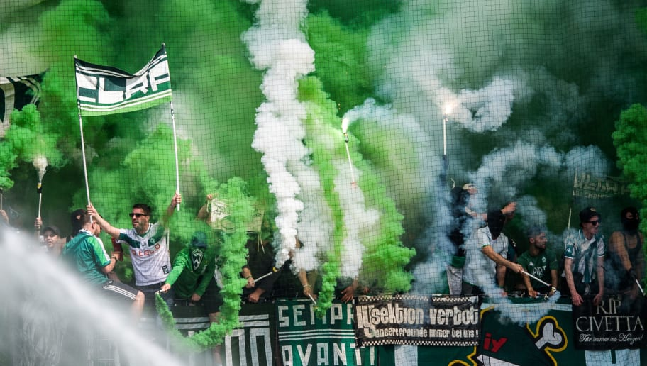 MAINZ, GERMANY - MAY 12: Fans of Bremen ignite smoke bombs prior to the Bundesliga match between 1. FSV Mainz 05 and SV Werder Bremen at Opel Arena on May 12, 2018 in Mainz, Germany. (Photo by Lukas Schulze/Bongarts/Getty Images)