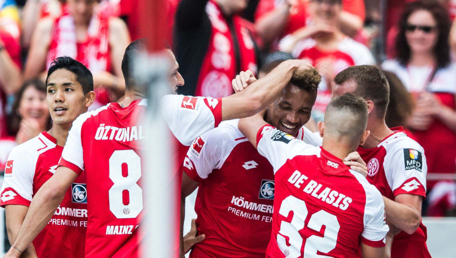 MAINZ, GERMANY - MAY 12: Jean-Philippe Gbamin (C) of Mainz celebrates his teams first goal with team mates  during the Bundesliga match between 1. FSV Mainz 05 and SV Werder Bremen at Opel Arena on May 12, 2018 in Mainz, Germany. (Photo by Lukas Schulze/Bongarts/Getty Images)