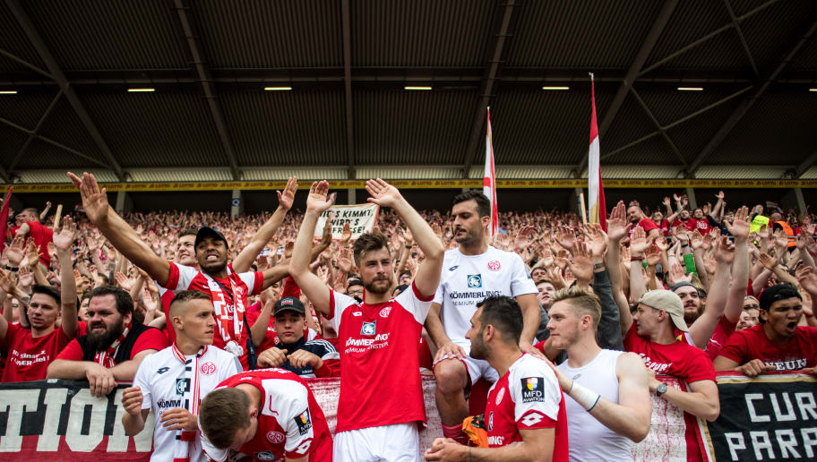 MAINZ, GERMANY - MAY 12: Fans and players of Mainz celebrate after the Bundesliga match between 1. FSV Mainz 05 and SV Werder Bremen at Opel Arena on May 12, 2018 in Mainz, Germany. (Photo by Lukas Schulze/Bongarts/Getty Images)