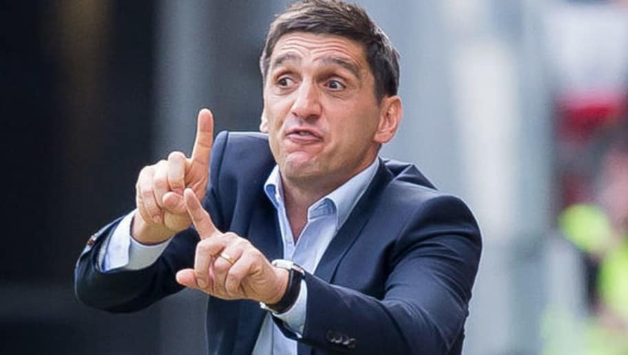 MAINZ, GERMANY - AUGUST 26: Head coach Tayfun Korkut of Stuttgart gestures during the Bundesliga match between 1. FSV Mainz 05 and VfB Stuttgart at Opel Arena on August 26, 2018 in Mainz, Germany. (Photo by TF-Images/Getty Images)