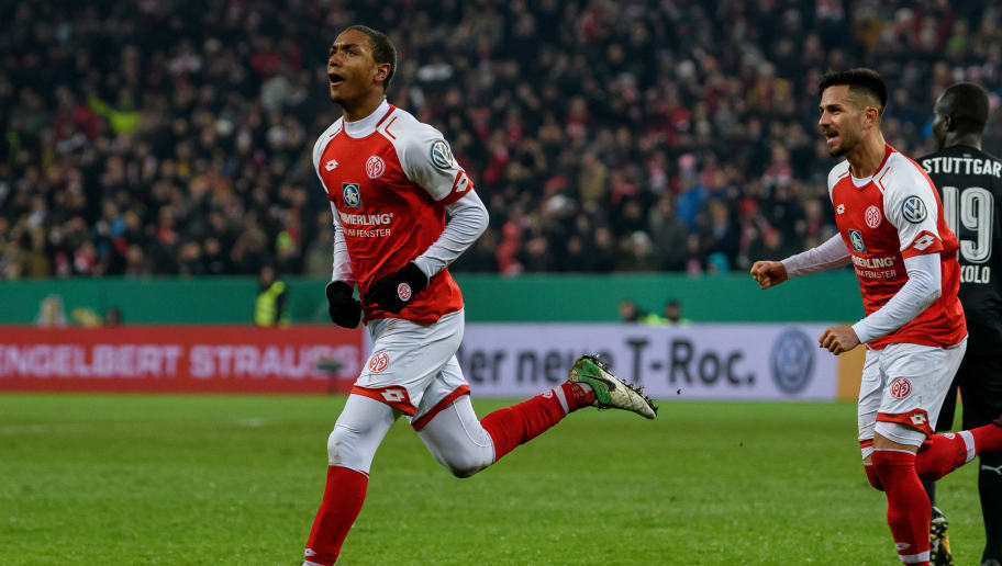 MAINZ, GERMANY - DECEMBER 19: Abdou Diallo of Mainz celebrates the second goal for his team with his teammates during the DFB Cup match between 1. FSV Mainz 05 and VfB Stuttgart at Opel Arena on December 19, 2017 in Mainz, Germany. (Photo by Alexander Scheuber/Bongarts/Getty Images)