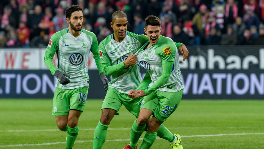 MAINZ, GERMANY - FEBRUARY 23: Josip Brekalo of Wolfsburg celebrates the first goal for his team with Yunus Malli of Wolfsburg and Daniel Didavi of Wolfsburg during the Bundesliga match between 1. FSV Mainz 05 and VfL Wolfsburg at Opel Arena on February 23, 2018 in Mainz, Germany. (Photo by Alexander Scheuber/Bongarts/Getty Images)