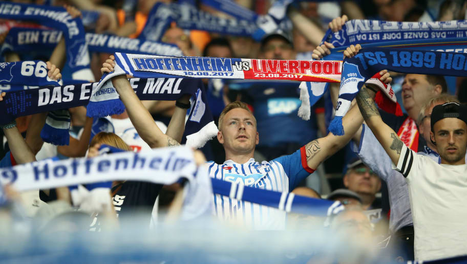 SINSHEIM, GERMANY - AUGUST 15: Fans hold their scarves prior to the UEFA Champions League Qualifying Play-Offs Round First Leg match between 1899 Hoffenheim and Liverpool FC at Wirsol Rhein-Neckar-Arena on August 15, 2017 in Sinsheim, Germany.  (Photo by Alex Grimm/Bongarts/Getty Images)