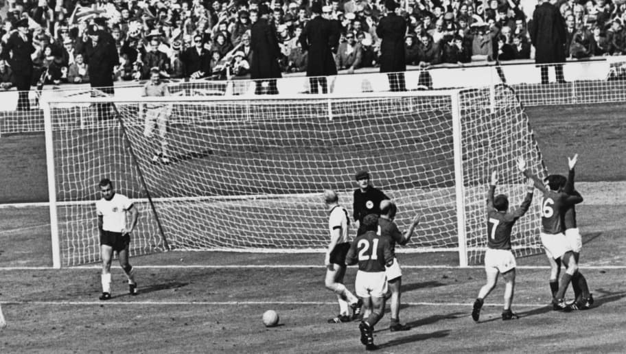 The England team celebrate after Geoff Hurst scores the controversial third goal against West Germany during the World Cup final at Wembley Stadium, 30th July 1966. The goal was eventually given and England won the match 4-2. (Photo by Getty Images)
